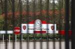 Closed gates at Arsenal's London Colney training ground in London, Friday, March 13, 2020. Arsenal manager Mikel Arteta has tested positive for the coronavirus. It has forced the club to close its training complex, put the entire first-team in self isolation and for its Premier League match against Brighton on Saturday to be postponed. (Bradley Collyer/PA via AP)