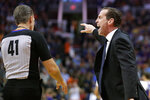 Brooklyn Nets coach Kenny Atkinson yells to referee Ken Mauer (41) during the first half of the team's NBA basketball game against the Phoenix Suns, Sunday, Nov. 10, 2019, in Phoenix. Atkinson was called for a technical foul. (AP Photo/Matt York)