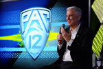 Pac-12 Commissioner George Kliavkoff fields questions during the Pac-12 Conference NCAA college football Media Day Tuesday, July 27, 2021, in Los Angeles. (AP Photo/Marcio Jose Sanchez)