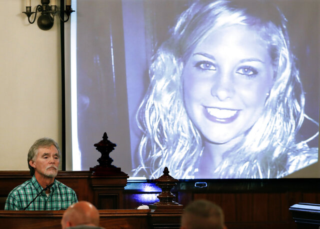 FILE - In this Sept. 11, 2017 file photo, Dana Bobo, let, father of Holly Bobo testifies in the trial of Zachary Adams as a photo of Holly Bobo is displayed in Savannah, Tenn. Jason Autry pleaded guilty Monday, Sept. 14, 2020 to taking part in the killing of Tennessee nursing student Holly Bobo more than nine years ago, but he is expected to be released soon as part of a deal with prosecutors. (AP Photo/Mark Humphrey, Pool, File)