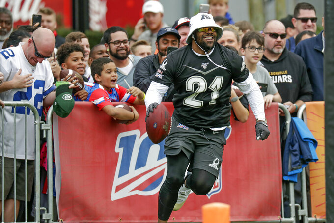 AFC running back Mark Ingram, of the Baltimore Ravens (21), runs back on the field after he jumped over the railing to have some fun with fans during a practice for the NFL Pro Bowl football game Thursday, Jan. 23, 2020, in Kissimmee, Fla. (AP Photo/John Raoux)