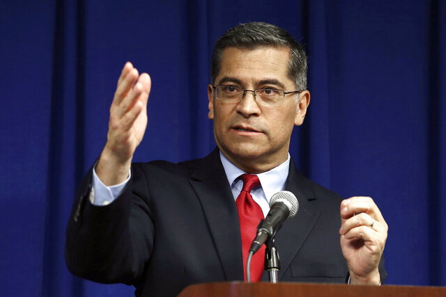 FILE - In this March 5, 2019, file photo, California Attorney General Xavier Becerra speaks during a news conference in Sacramento, Calif. California is seeking to join the Justice Department in its antitrust lawsuit against Google parent Alphabet Inc., one of the state's largest businesses. State Attorney General Xavier Becerra filed the motion to join the case in federal court on Friday, Dec. 11, 2020. (AP Photo/Rich Pedroncelli, File)