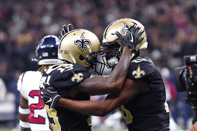 New Orleans Saints wide receiver Tre'Quan Smith, right, celebrates his touchdown reception with wide receiver Ted Ginn (19) in the second half of an NFL football game against the Houston Texans in New Orleans, Monday, Sept. 9, 2019. (AP Photo/Bill Feig)