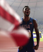 Noah Lyles of the U.S., celebrates winning the gold medal in the men's 200 meter final at the World Athletics Championships in Doha, Qatar, Tuesday, Oct. 1, 2019. (AP Photo/Nariman El-Mofty)