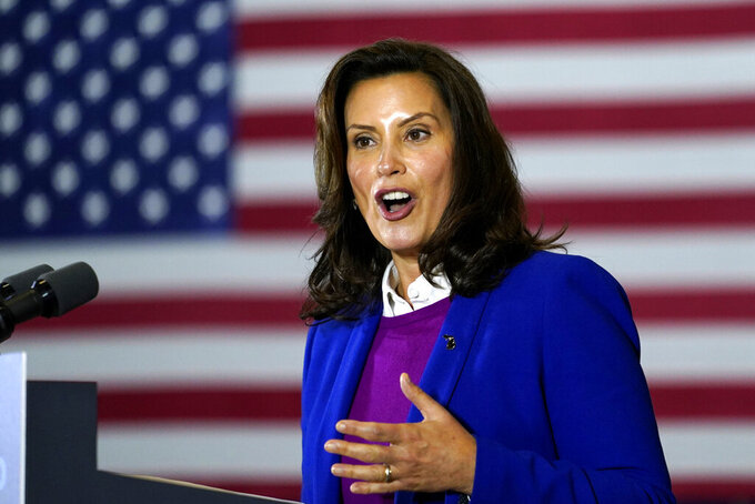FILE - In this Oct. 16, 2020 file photo, Michigan Gov. Gretchen Whitmer speaks at Beech Woods Recreation Center, in Southfield, Mich. Whitmer on Thursday, April 15, 2021,  announced changes in the state's contracting process to ensure construction and other companies are not rewarded with government money for payroll fraud such as misclassifying workers as independent contractors. (AP Photo/Carolyn Kaster, File)