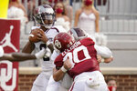 Missouri State quarterback Jaden Johnson, left, looks to pass in the first half of an NCAA college football game against Oklahoma Saturday, Sept. 12, 2020, in Norman, Okla. (AP Photo/Sue Ogrocki, Pool)