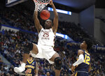 Florida State's Mfiondu Kabengele (25) dunks over Murray State's Ja Morant (12) during the second half of a second round men's college basketball game in the NCAA Tournament, Saturday, March 23, 2019, in Hartford, Conn. Florida State won 90-62. (AP Photo/Elise Amendola)