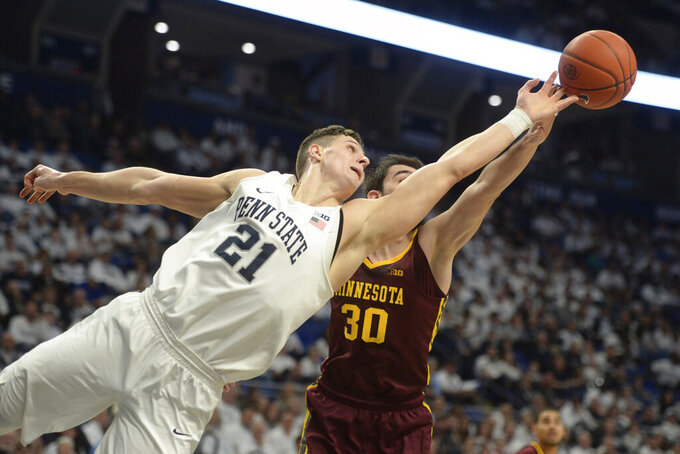 Penn State's John Harrar (21) and Minnesota's Alihan Demir (30) lunge for a rebound during the first half of an NCAA college basketball game, Saturday, Feb. 8, 2020, in State College, Pa. (AP Photo/Gary M. Baranec)