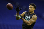 Southern Illinois defensive back Jeremy Chinn runs a drill at the NFL football scouting combine in Indianapolis, Sunday, March 1, 2020. (AP Photo/Michael Conroy)