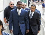FILE - In this Aug. 27, 2007, file photo, Atlanta Falcons quarterback Michael Vick arrives with his attorney Billy Martin, right, at federal court in Richmond, Va. Vick served 18 months in prison following his guilty plea for a dogfighting operation in his native Virginia. (AP Photo/Steve Helber, Pool, File)