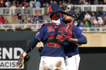 Minnesota Twins catcher Ryan Jeffers (27) and pitcher Alex Colome celebrate after they defeated the Milwaukee Brewers in a baseball game Saturday, Aug. 28, 2021, in Minneapolis. (AP Photo/Jim Mone)