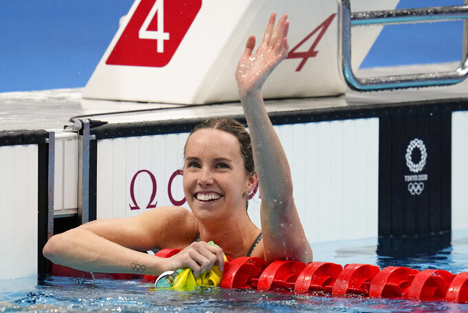 CORRECTS NAME AND RACE - Emma Mckeon, of Australia, celebrates after winning the gold medal in the women's 100-meter freestyle final at the 2020 Summer Olympics, Friday, July 30, 2021, in Tokyo, Japan. (AP Photo/Jae C. Hong)