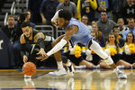 Marquette's Markus Howard, left, and Villanova's Saddiq Bey, right, vie for a loose ball during the first half of an NCAA college basketball game Saturday, Jan. 4, 2020, in Milwaukee. (AP Photo/Aaron Gash)