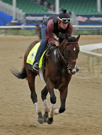 Kentucky Derby hopeful Omaha Beach is ridden during a workout at Churchill Downs Tuesday, April 30, 2019, in Louisville, Ky. The 145th running of the Kentucky Derby is scheduled for Saturday, May 4. (AP Photo/Charlie Riedel)