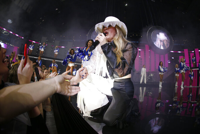 Artist Ellie Goulding performs at half time of an NFL football game between the Buffalo Bills and Dallas Cowboys in Arlington, Texas, Thursday, Nov. 28, 2019. (AP Photo/Ron Jenkins)