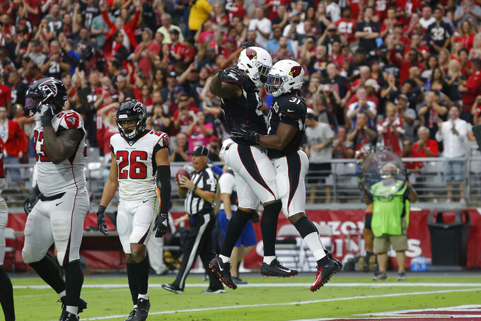 Arizona Cardinals running back David Johnson (31) celebrates his touchdown with teammate tight end Charles Clay against the Atlanta Falcons during the first half of an NFL football game, Sunday, Oct. 13, 2019, in Glendale, Ariz. (AP Photo/Rick Scuteri)