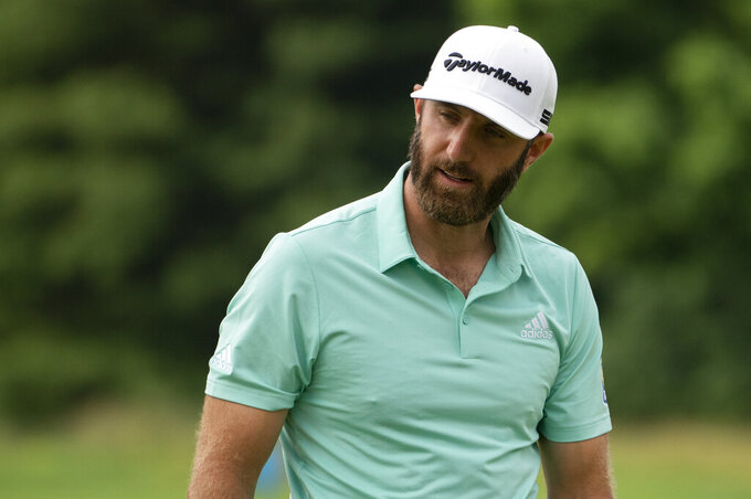 Dustin Johnson reacts to a missed put on the fourth green during the third round of the Travelers Championship golf tournament at TPC River Highlands, Saturday, June 26, 2021, in Cromwell, Conn. (AP Photo/John Minchillo)