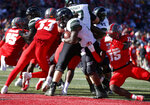 Hawaii running back Miles Reed (26) scores a touchdown against New Mexico safety Letayveon Beaton (15) during the first half of an NCAA college football game on Saturday, Oct. 26, 2019 in Albuquerque, N.M. (AP Photo/Andres Leighton)