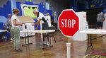 Social distancing for voting at precinct 61 in Edmond, Okla., Tuesday, June 30, 2020. (Doug Hoke/The Oklahoman via AP)
