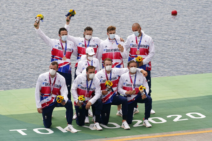 Josh Bugajski, Jacob Dawson, Tom George, Mohamed Sbihi, Charles Elwes, Oliver Wynne-Griffith, James Rudkin, Tom Ford, and Henry Fieldman, of Britain pose after winning the bronze medal in the men's rowing eight final at the 2020 Summer Olympics, Friday, July 30, 2021, in Tokyo, Japan. (AP Photo/Darron Cummings)