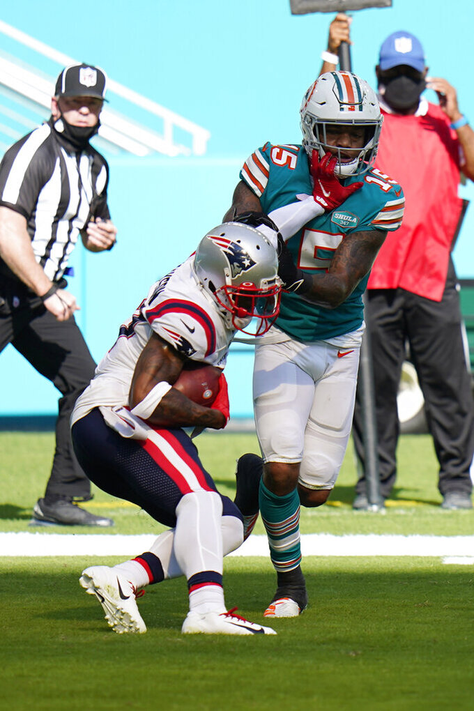 New England Patriots cornerback J.C. Jackson (27) intercepts a pass in the enzone intended for Miami Dolphins running back Lynn Bowden (15), during the first half of an NFL football game, Sunday, Dec. 20, 2020, in Miami Gardens, Fla. (AP Photo/Chris O'Meara)