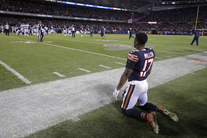 Chicago Bears wide receiver Anthony Miller (17) watches after kicker Cody Parkey (1) misses a field goal in the final minute during the second half of an NFL wild-card playoff football game against the Philadelphia Eagles Sunday, Jan. 6, 2019, in Chicago. The Eagles won 16-15. (AP Photo/Nam Y. Huh)