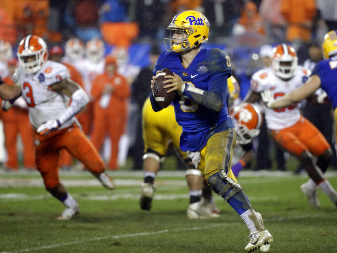 Pittsburgh's Kenny Pickett (8) rolls out to pass against Clemson in the first half of the Atlantic Coast Conference championship NCAA college football game in Charlotte, N.C., Saturday, Dec. 1, 2018. (AP Photo/Chuck Burton)