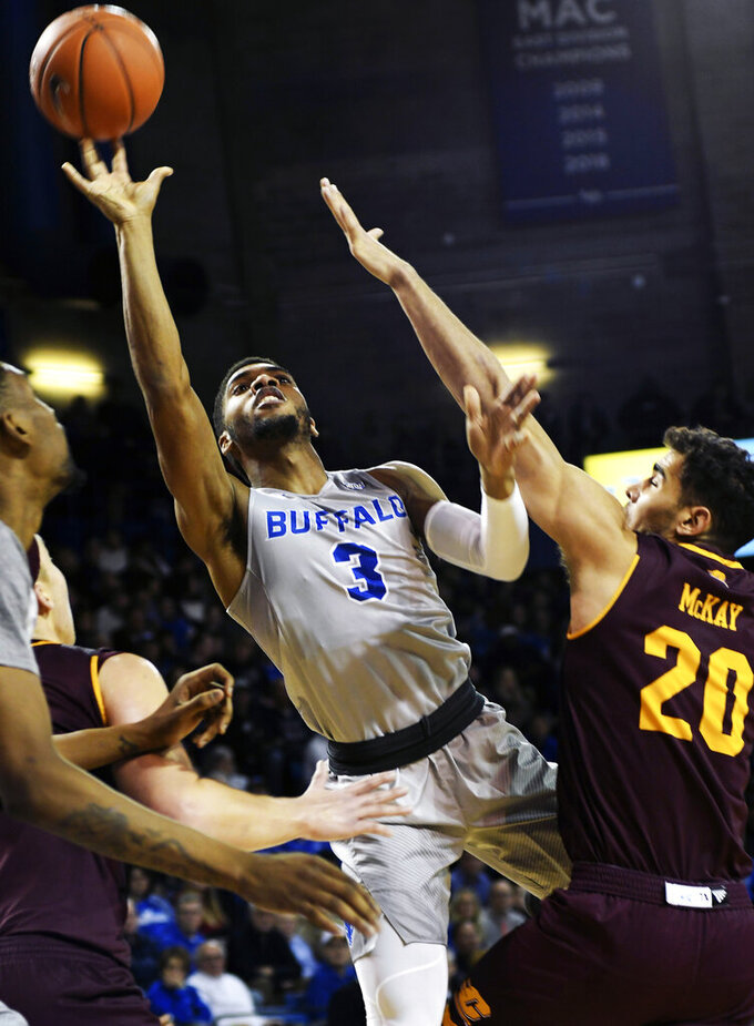 Buffalo's Jayvon Graves shoots at the basket against Central Michigan's Keivn McKay during an NCAA college basketball game in Buffalo, N.Y., Saturday, Feb. 9, 2019. (AP Photo/Heather Ainsworth)