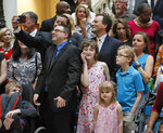 Medical marijuana users, their families and advocates take photos as they wait for the signing. Gov. Brian Kemp signed HB 324 Wednesday, a bill that will allow medical marijuana oil to be sold in Georgia for the first time. The legislation would provide a way for the state's 9,000-plus medical marijuana patients to buy the drug they're already allowed to use. (Bob Andres/Atlanta Journal-Constitution via AP)
