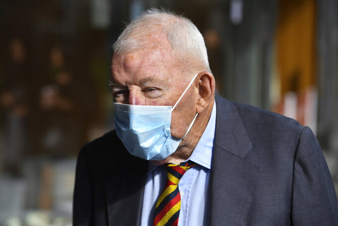 Ron Brierley leaves the Downing Centre District Court in Sydney, Thursday, April 1, 2021. Brierley, one of New Zealand's most well-known businessmen, pleaded guilty Thursday to possessing child sex abuse images, including some of children as young as 2. (Mick Tsikas/AAP Image via AP)