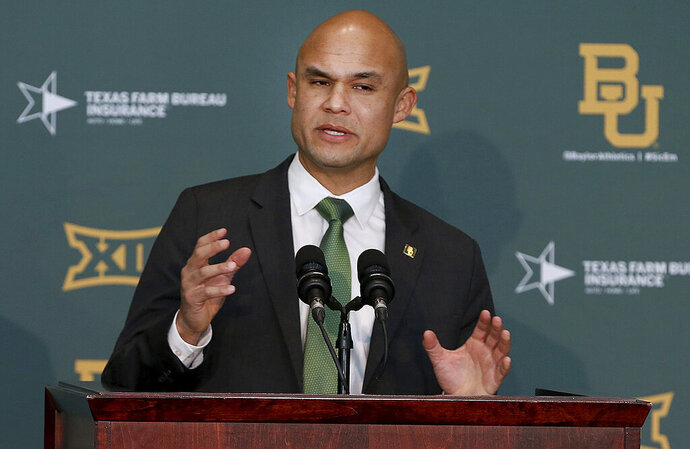 FILE - In this Jan. 20, 2020 file photo, Baylor's new head football coach Dave Aranda addresses the media during an NCAA college football news conference in Waco, Texas.   Aranda will make his delayed debut as Baylor's coach in a quickly arranged and unexpected reunion of old Southwest Conference rivals. Baylor and Houston open this pandemic-altered season Saturday, Sept. 19,  with their first meeting since the SWC's final season in 1995.  (Jerry Larson/Waco Tribune-Herald via AP, File)