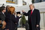 President Donald Trump speaks to reporters upon arrival at the White House in Washington, Sunday, Nov. 3, 2019. (AP Photo/Manuel Balce Ceneta)