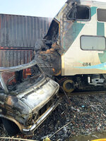 This photo provided by the Norwalk Sheriff's Station shows the scene after an RV was hit by a commuter train and burst into flames along a track in Santa Fe Springs, Calif., Friday, Nov. 22, 2019. Authorities say the collision occurred shortly after 5:30 a.m. Friday at an intersection in an industrial area of Santa Fe Springs. There were no immediate reports of injuries. All passengers on the Metrolink train were safely evacuated. (Norwalk Sheriff's Station via AP)