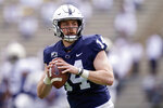 FILE - In this April 17, 2021, file photo, Penn State quarterback Sean Clifford (14) looks to pass during NCAA college football practice in State College, Pa. Penn State faces Wisconsin on Saturday as they open their college football season. (AP Photo/Keith Srakocic, File)