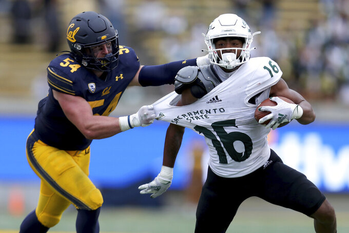 California linebacker Evan Tarrersall (54) tackles Sacramento State tight end Marshel Martin (16) during the second half of an NCAA college football game on Saturday, Sept. 18, 2021, in Berkeley, Calif. (AP Photo/Jed Jacobsohn)