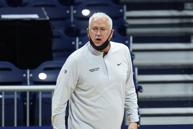 Oregon State head coach Wayne Tinkle watches against Oklahoma State during the first half of a men's college basketball game in the second round of the NCAA tournament at Hinkle Fieldhouse in Indianapolis, Sunday, March 21, 2021. (AP Photo/Paul Sancya)