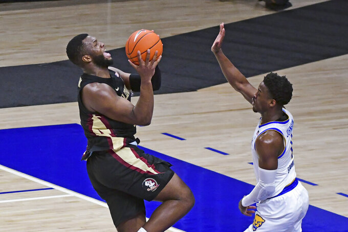 Florida State forward Raquan Gray, left, goes in for a shot over Pittsburgh guard Xavier Johnson during the first half of an NCAA college basketball game, Saturday, Feb. 20, 2021, in Pittsburgh. (AP Photo/Fred Vuich)