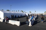 Voters wait for an early voting site to open during the first day of early voting in Henderson, Nev. Saturday, Oct. 17, 2020. (Steve Marcus/Las Vegas Sun via AP)
