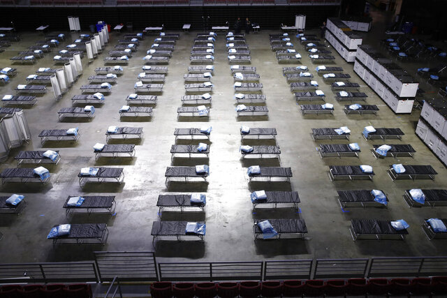 A federal medical station is set up at Temple University's Liacouras Center in Philadelphia, Monday, March 30, 2020, to accommodate an influx in hospital patients due to the coronavirus outbreak. (AP Photo/Matt Rourke)