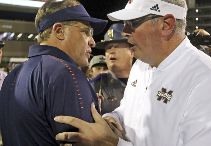 Auburn coach Gus Malzahn, left congratulates Mississippi State coach Joe Moorhead after an NCAA college football game Saturday, Oct. 6, 2018, in Starkville, Miss. MSU won 23-9. (AP Photo/Jim Lytle)