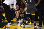Golden State Warriors guard Klay Thompson, center, is helped up after being injured during the second half of Game 6 of basketball's NBA Finals against the Toronto Raptors in Oakland, Calif., Thursday, June 13, 2019. (AP Photo/Tony Avelar)