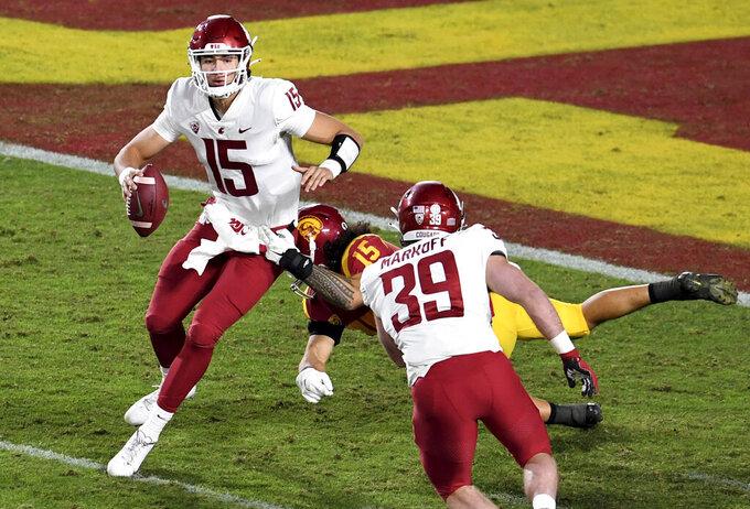 Southern California safety Talanoa Hufanga (15) sacks Washington State quarterback Gunner Cruz (15) in the second half of an NCAA college football game in Los Angeles, Sunday, Dec. 6, 2020. (Keith Birmingham/The Orange County Register via AP)