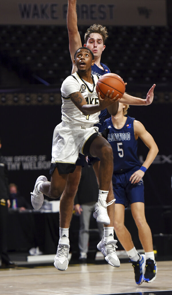 Wale Forest's Daivien Williamson shoots in front of Longwood's Nate Lliteras during the first half of an NCAA basketball game Friday, Nov. 27, 2020, in Winston-Salem, N.C. (Walt Unks/The Winston-Salem Journal via AP, Pool)