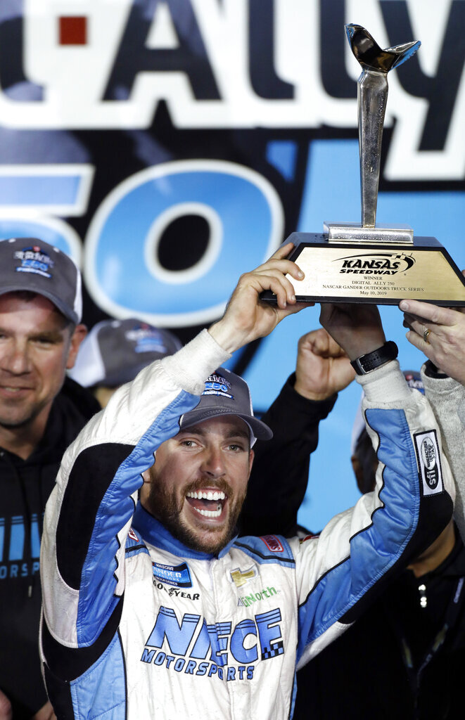 Ross Chastain celebrates in Victory Lane following the NASCAR Truck Series auto race at Kansas Speedway in Kansas City, Kan., Friday, May 10, 2019. (AP Photo/Colin E. Braley)