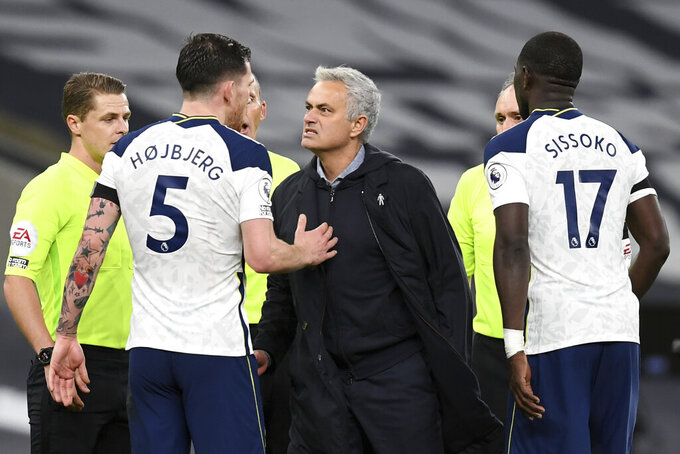 Tottenham's manager Jose Mourinho, center, reacts as speaks with Tottenham's Pierre-Emile Hojbjerg end of the English Premier League soccer match between Tottenham Hotspur and Manchester City at Tottenham Hotspur Stadium in London, England, Saturday, Nov. 21, 2020. (Neil Hall/Pool via AP)