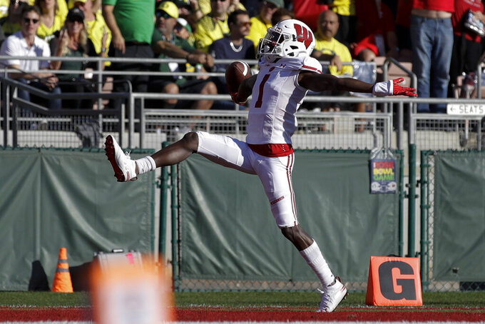 Wisconsin wide receiver Aron Cruickshank celebrates after scoring against Oregon during first half of the Rose Bowl NCAA college football game Wednesday, Jan. 1, 2020, in Pasadena, Calif. (AP Photo/Marcio Jose Sanchez)