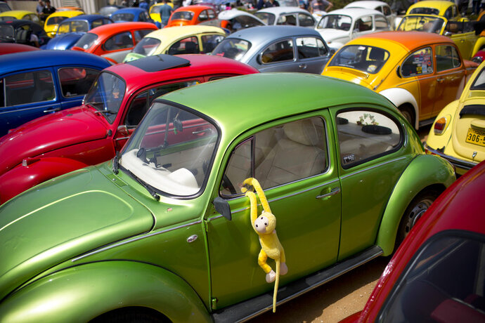 FILE- In this April 21, 2017, file photo Volkswagen Beetles displayed during the annual gathering of the