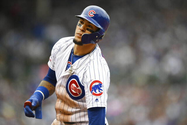 FILE - IN this Sept. 1, 2019 file photo, Chicago Cubs' Javier Baez reacts after being forced out at first base during the fifth inning of a baseball game against the Milwaukee Brewers in Chicago. Baez wants his Cubs to be better prepared this season.  The two-time All-Star said Sunday, Feb. 16, 2020 at spring training that he and the Cubs were lacking last year when it came to their pregame routines and work ethic. (AP Photo/Paul Beaty, File)