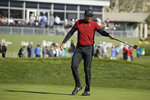 Jason Day, of Australia, looks over the 18th green of the Pebble Beach Golf Links during the second round of the AT&T Pebble Beach National Pro-Am golf tournament Friday, Feb. 7, 2020, in Pebble Beach, Calif. (AP Photo/Eric Risberg)