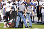 An animal rights protester is dragged off the football field at Davis Wade Stadium by Mississippi Highway Patrol troopers during the first half of an NCAA college football game between Texas A&M and Mississippi State in Starkville, Miss., Saturday Oct. 17, 2020. (AP Photo/Rogelio V. Solis)